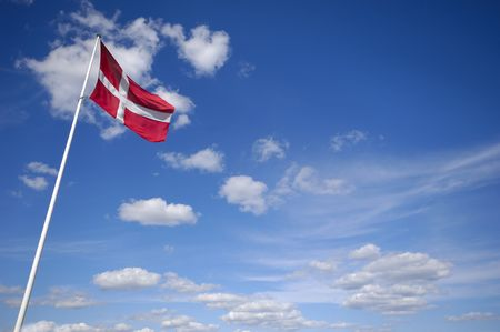 flagpoles: The danish flag and blue and cloudy sky Stock Photo