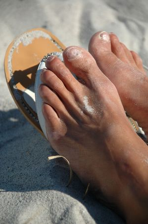 painted toes: Sandals and feet in sand