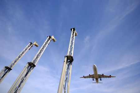 A plane is going to land in an airport. Note the plane is in motion blur Stock Photo - 3415262