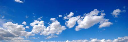 White cumulus clouds and blue sky photo