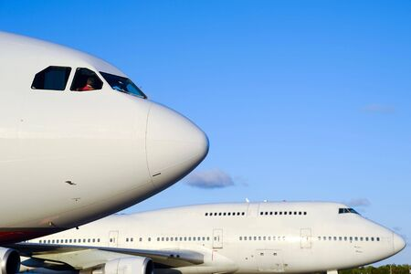 Two jumbo jet planes in an airport.  Stock Photo