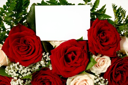 Bouquet of rose flowers with a blank gift card, write your own tekst. photo