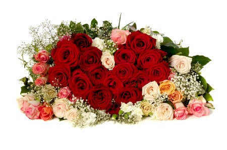 Bouquet of rose flowers isolated on white background. The roses are aranged as a heart shape.