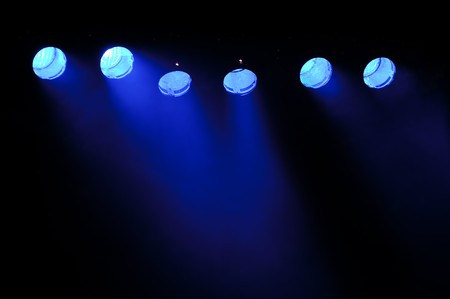 light show: Lights and smoke. Row of blue lights from a stage.