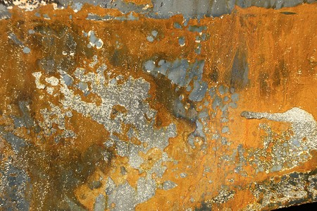 Grungy abstract background of metal. From a burnt out car. photo
