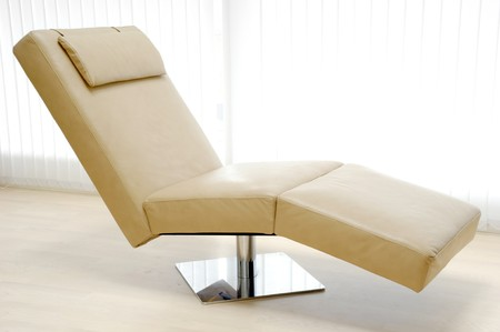 furnish: A very trendy leather sofa in a room. Stock Photo