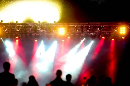 Crowd of people in front of spotlights at a concert. photo