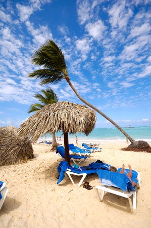 Sunbeds and parasol on an exotic beach. Dominican Republic, Punta Cana. photo