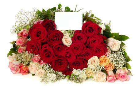 Bouquet of rose flowers with a blank gift card, isolated on white background. The roses are arranged in heart shape. photo