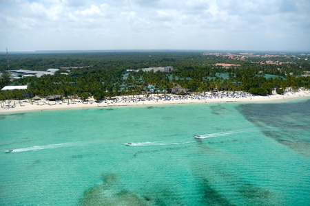 speedboats: Speedboats and a exotic beach. Taken form above in helicopter. Stock Photo