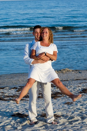 A happy woman and man in love at beach. photo
