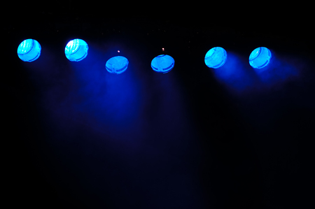 performace: Lights and smoke  Row of blue lights from a stage  Stock Photo