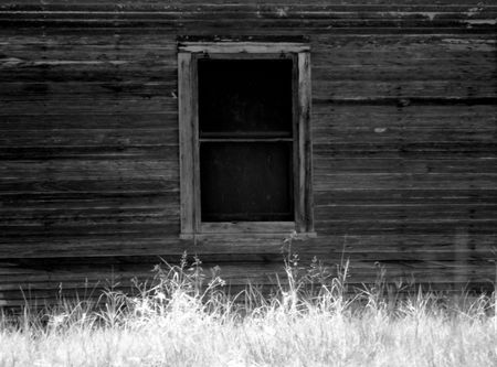 home made: An infrared black and white photograph of the window of an old house.