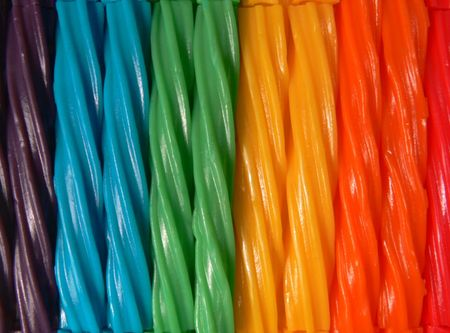 A closeup/macro photograph of licorice twists in a variety of colors that make up the color spectrum. Stock Photo - 6048142