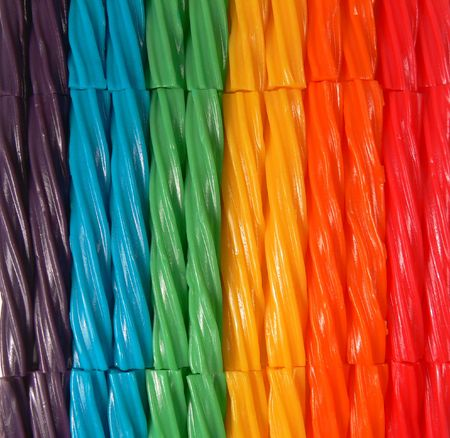 twists: A closeupmacro photograph of licorice twists in a variety of colors that make up the color spectrum.