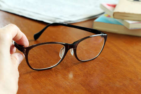 inconvenience: Glasses and books and newspapers Stock Photo