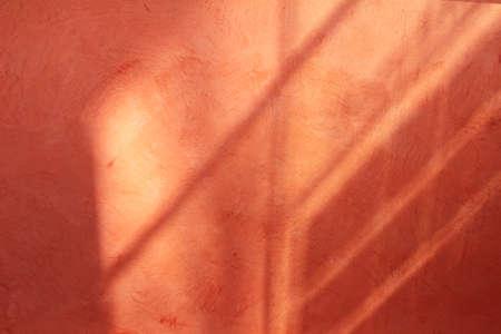 wall light: Pink orange wall Stock Photo