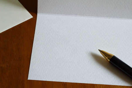 a courtesy: Post cards and pen Stock Photo