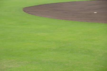 outfield: Outfield grass of a baseball field