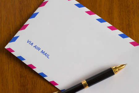 Air mail and pen Stock Photo