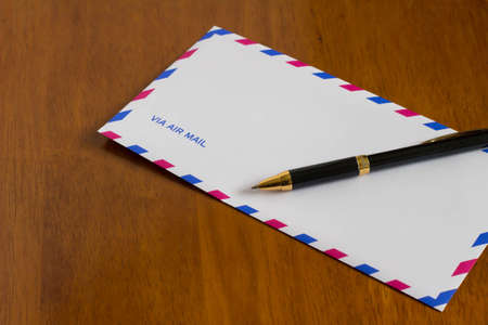 a courtesy: Air mail and pen Stock Photo