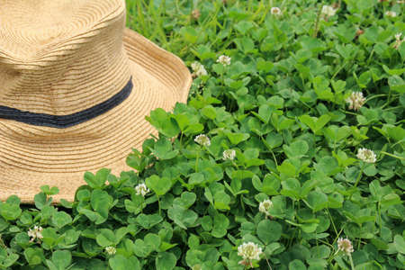 Straw hat and white clipper Stock Photo