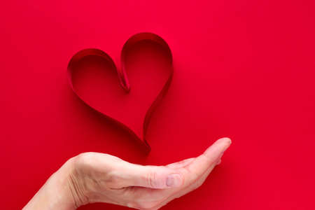 Image Of A Red Heart On Top Of A Palm Symbolic Of Love Stock Photo