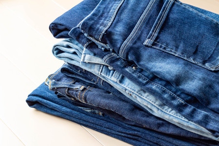 Bottoms of folded denim jeans