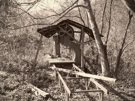 sawmill: Old abandoned riverside sawmill, sepia