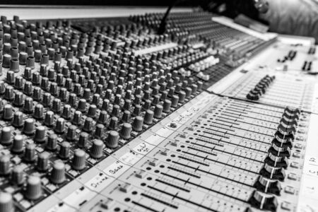 B&W Analog sound mixing console used to mix music and microphones