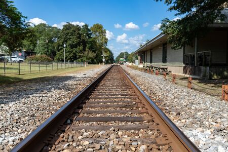 Train tracks passing through small town in rural America