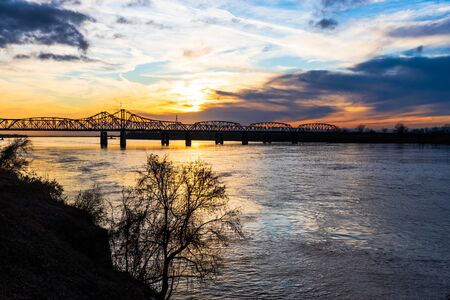 Sunset landscape of the Mississippi River bridge between Mississippi and Louisiana, in Vicksburg, MS.