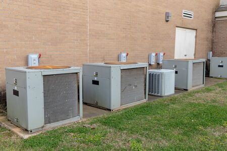 Commercial Air Conditioner compressors outside of brick building