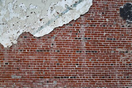Old Vintage painted Brick and mortar wall with plaster and pealing paint, background texture