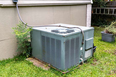 Package Air Conditioner system next to a home.