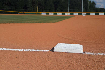 Baseball Field 1st Base with fresh grass and chalk lines