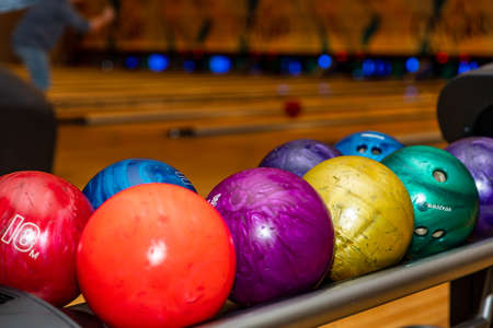 Colorful and vibrant bowling balls, with lanes in the background, with copy space
