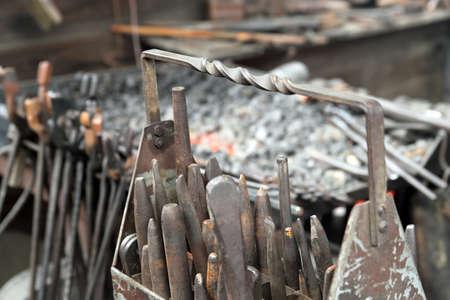 vintage cold chisels in blacksmith workshop