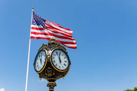 Mooresville, NC, USA: Clock and American Flag at the Trump National Golf Club Charlotte
