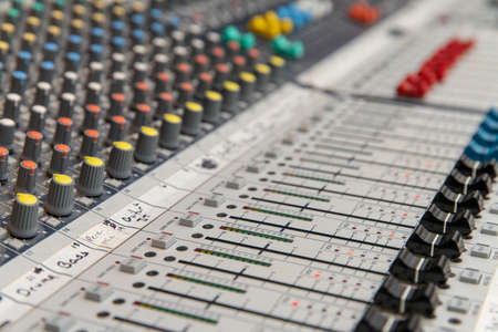Analog sound mixing console used to mix music and microphones Banco de Imagens