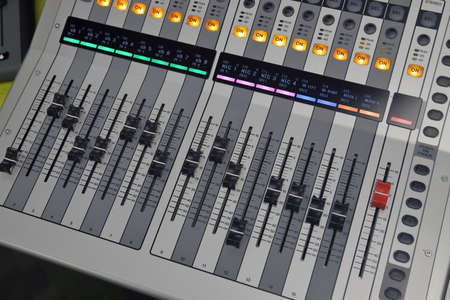 Digital Audio Sound mixing console used for mixing microphones, music, bands, etc. Banco de Imagens