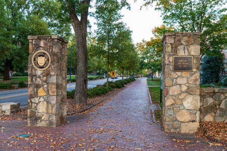 Chapel Hill, NC / USA - October 23, 2020: Stone entrance to the University of North Carolina Chapel hill with brick sidewalk