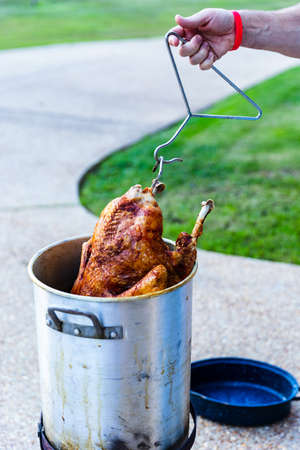 Frying a whole turkey outdoors for the holiday feast