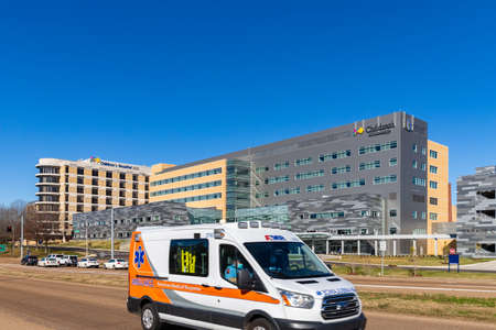 Jackson, MS - January 5, 2021: An AMR Ambulance passes in front of  Children's Hospital at the University of Mississippi Medical Center