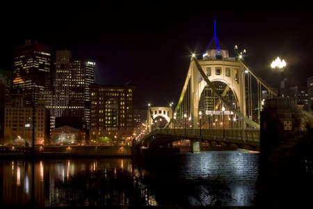 Suspension bridge leading to the city photo