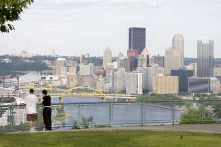 overlooking: Young Couple Overlooking City