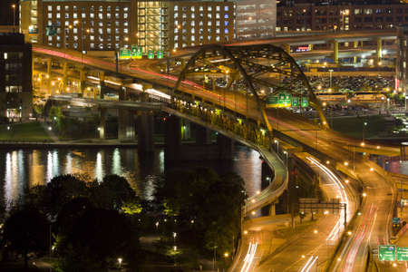 Vehicle Traffic on a bridge in downtown Pittsburgh, PA photo