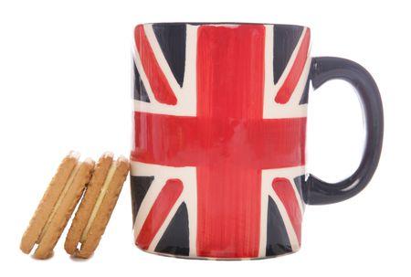 イギリスお茶マグカップとビスケット スタジオの排気切替器 写真素材