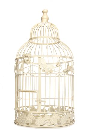 Vintage looking bird cage isolated studio cutout 写真素材