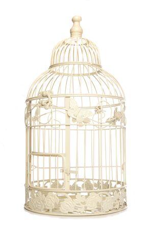 Vintage looking bird cage isolated studio cutout Stock Photo